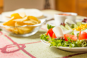 Traditional mexican food with a plate of fresh salad, tortillas,