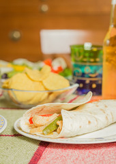 Traditional mexican food with a plate of chicken fajita, fresh s