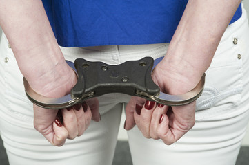 Woman in police issue handcuffs