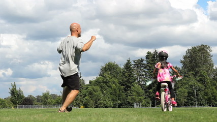 Father Celebrates Daughter Riding Bike Without Training Wheels