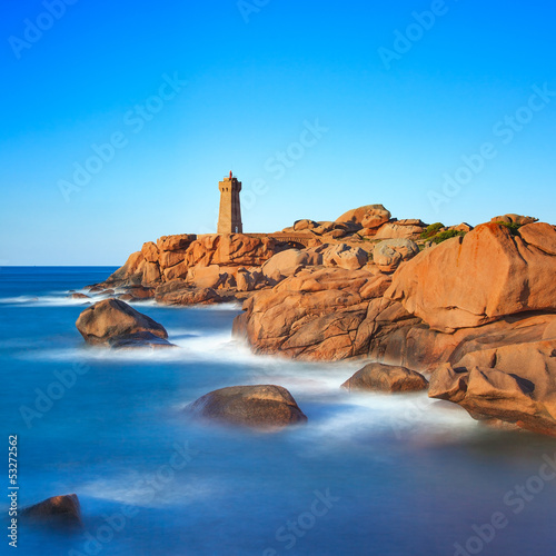 Ploumanach lighthouse sunset in granite coast, Brittany, France.