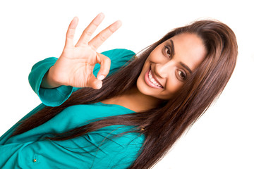 Beautiful mix race woman showing Ok sign