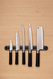 Set of knives on a magnetic holder