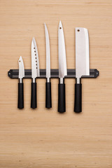 Set of knives on a magnetic holder