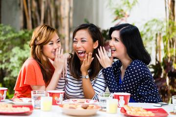 Asian women gossiping about things