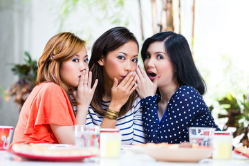Asian women gossiping about things