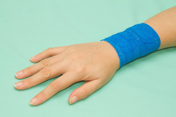 Blue medicine bandage on injury hand