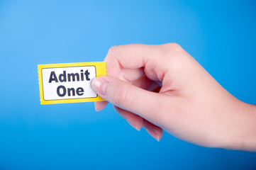 "Female Hand Holding ""ADMIT ONE"" Ticket"