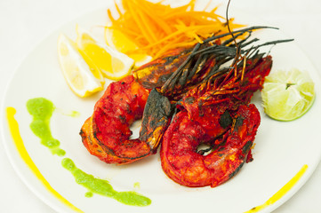 Tandoori prawns with lemon.