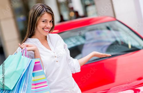 Shopping woman winning a car