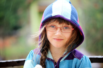 Close-up portrait of little girl in a hoody
