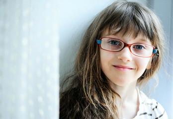 Close-up portrait of brunette child girl