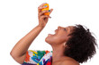 Overweight young black woman drinking orange juice - African peo