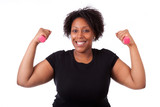 Portrait of a black fatty woman working out with free weights -