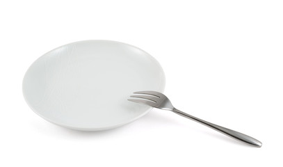 Metal fork in a ceramic plate isolated
