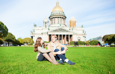 Couple on the grass near St. Isaac's cathedral
