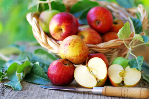 Apples on table and knife