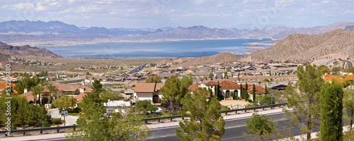 Lake Meade Bolder City Nevada suburb and mountains panorama.