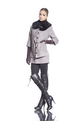 Full length beautiful fashion woman in boots posing