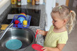 Little girl playing in the kitchen
