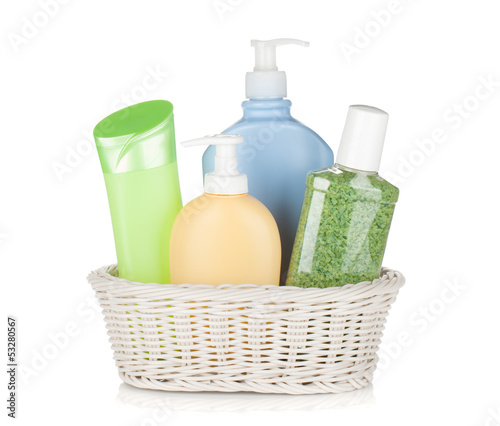 Cosmetics bottles in basket