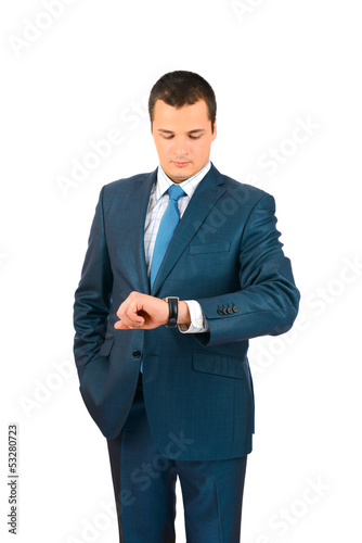 Handsome businessman checking time