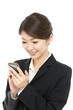 Beautiful asian business woman using a cellular