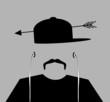 man with arrow through baseball cap