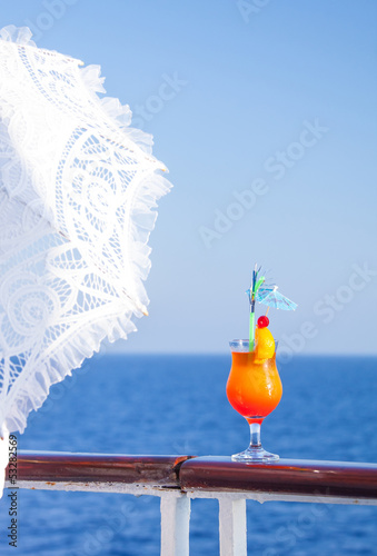 Girl with an umbrella to enjoy the journey drinking cocktail
