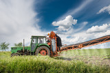 tractor spraying pesticides poster