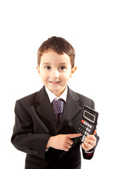 Small boy in dark suit with calculator