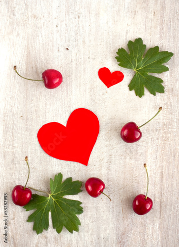 red sweet cherry and hearts