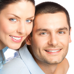 Portrait of young smiling attractive couple