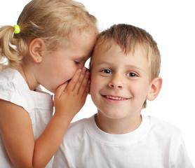 Girl whispers a secret