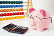 Piggy Bank With Abacus And Calculator