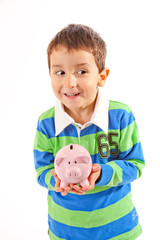 Small Boy Holding Piggy Bank