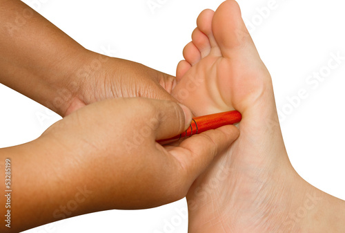 Reflexology foot massage, thai spa foot treatment by wood stick