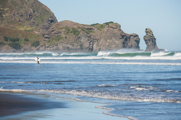 surfer on Piha beach