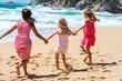 Three girlfriends having fun on beach.