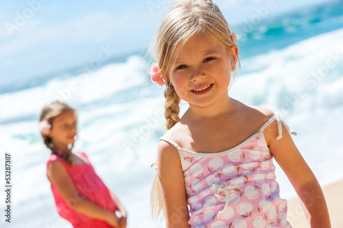 Portrait of cute girl on beach.