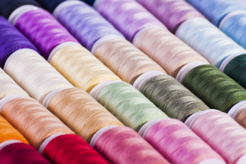Colourful cotton reels background