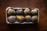 Figs in the box on wooden table