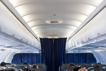 Plane interior view with seats.