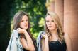 Two beautiful girls outdoors portrait.