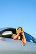 Woman calling by cellphone on car