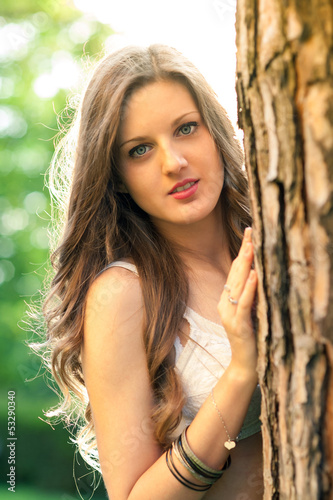 Beautiful girl outdoors backlight portrait.
