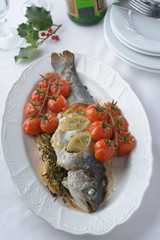Baked trout on a Christmas table