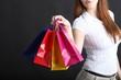shopping - Frau hält Einkaufstaschen