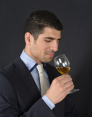 Portrait of a sommelier skeptical for quality of wine