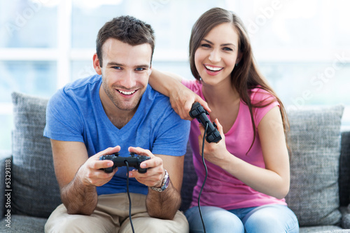 Couple on sofa playing video games